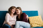 Mature Mother Hugging Her Affectionate Teen Daughter poster