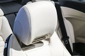 Modern Luxury Car Perforated Stitched White Leather Interior.part Of Leather Car Seat Details. Moder poster