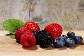 wild berries on a chopping board