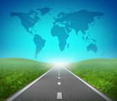image of international trade  - International road highway and global map with green grass and asphalt street representing the concept of journey to a focused international destination resulting in success in trade and political direction - JPG
