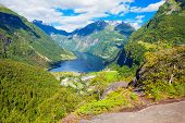 Geirangerfjord And Geiranger Village Aerial View From Flydalsjuvet Viewpoint, Norway poster