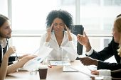 Stressed Overwhelmed African Businesswoman Feels Tired At Corporate Meeting, Exhausted Black Female  poster