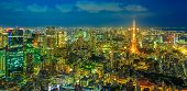 Panorama Of Tokyo Skyline At Blue Hour With Illuminated Tokyo Tower From Atop Observatory Of Mori To poster