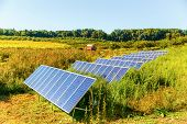 Solar Panels On The Farm. Solar System On The Corn Field poster