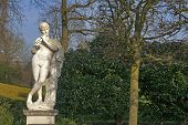 Marble Statue Of The Naked God Pan Playing A Flute In The Queens Garden Behind Kew Palace At The Roy poster