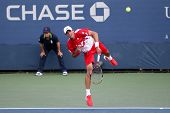 FLUSHING, NY - AUGUST 29: Thomaz Bellucci (BRA) serves at the 2011 US Open at the USTA Billie Jean K