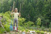 Little Girl Holding Gardening Tools, Having Fun In The Garden, Planting, Gardening, Helping Her Moth poster