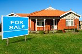 foto of residential home  - Home For Sale Sign in Front of New Home - JPG