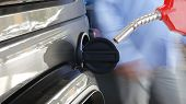 Gasoline pistol pump gun fuel nozzle and car on gas station poster