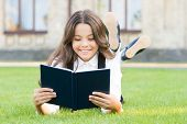 Knowledge Is More Than Information. Happy Small Girl Read Book On Green Grass. Adorable Little Schoo poster
