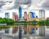 Austin, Texas, USA downtown skyline on the Colorado River with cloudy skies. poster