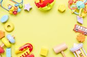Top View On Children S Toys On A Yellow Background. Childrens Toys On The Table. Concept For Adverti poster