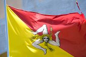 foto of sicily  - flag of Sicily with triskelion three - JPG