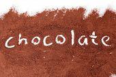Chocolate written in cocoa powder
