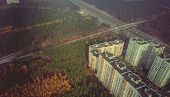 Aerial Top View Of Autumn Forest In Front Of The City. Aerial Top View Of Colorful Autumn Forest In  poster
