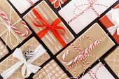 New Year Composition. Christmas Background With Red, Craft, White Wrapped Gifts Boxes With Colored R poster