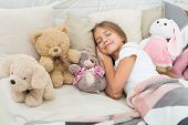 Relaxing Before Sleep. Girl Enjoy Evening Time With Toys. Kid Lay Bed With Toys Pillow Blanket Backg poster