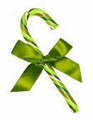 St Patricks Day Candy Cane With Green Bow Isolated On White