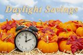 Daylight Savings Time Change Message With A Retro Alarm Clock With Orange Pumpkins With Fall Leaves  poster