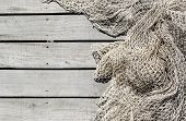 Fishing Net On Wooden Decking Of The Pier Background With Copy Space poster