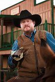 picture of hustler  - Tough old west cowboy on horseback with shotgun - JPG