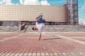 Male Athlete, Standing On One Arm In Jump, Summer City, Hip Hop Style, Breakdancer. Free Space For M poster