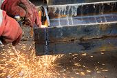 Cutting A Steel Beam With A Gas Torch. Industrial Metal Cutting. The Process Of Preparing A Steel Be poster