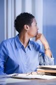 African American businesswoman thinking at desk