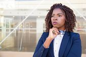 Pensive Serious Agent Waiting Customer Outside. Young African American Business Woman Standing At Ou poster