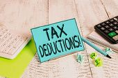Text Sign Showing Tax Deductions. Conceptual Photo Reduction Income That Is Able To Be Taxed Of Expe poster