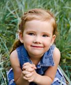 picture of cute little girl  - Portrait of smiling cute little girl in dress outdoor - JPG