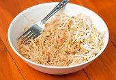 Stir Fried Mung Bean Noodle In Bowl On The Wooden Table