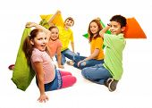 foto of pillow-fight  - Happy five teen kids Caucasian black and Asian boys and girls fighting with pillows laughing and having fun isolated on white - JPG