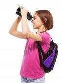 image of bagpack  - Beautiful teen girl with big smile holding binoculars isolated on white side view - JPG