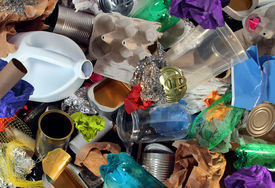stock photo of waste reduction  - Recycling garbage and reusable waste management as old paper glass metal and plastic household products to be reused as a concept of environmental conservation of material saving energy and money - JPG