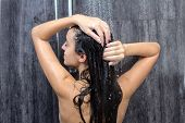 stock photo of douching  - sexy and happy young beautiful woman taking a shower