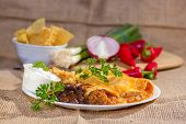 image of enchiladas  - Southwest beef enchilada with sourcream and black beans.