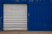 Shut Door On Blue Metal Shed