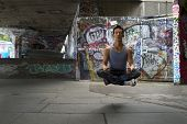 Young man levitating during meditation