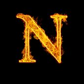 Fire alphabet letter N isolated on black background.