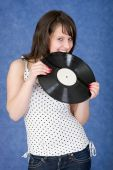 Girl Biting A Phonograph Record On A Blue