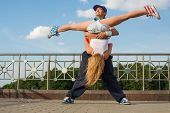 image of rap-girl  - Young people dancing modern dance in the street - JPG
