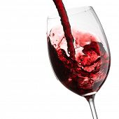stock photo of bordeaux  - Red Wine Pouring with splashes into wine glass - JPG