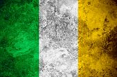 foto of irish flag  - flag of Ireland or Irish banner on vintage metal texture - JPG