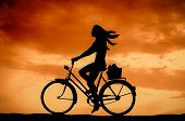 Retro Sunset Girl On A Bike