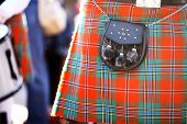 stock photo of kilt  - Color detail of a traditional Scottish kilt with a bag.