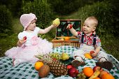 boy and girl on picnic in park