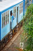 Bentota, Sri Lanka - 28 Apr 2013: Man Stay In A Door Of A Blue Train In Bentota, Sri Lanka. Trains A