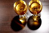 Luxury old whiskey glass on wood background