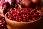 Ripe pomegranates on table close-up